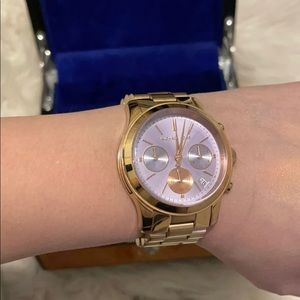 Rose Gold Michael Kors watch with baby purple face